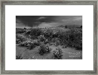 Distant Shower Framed Print