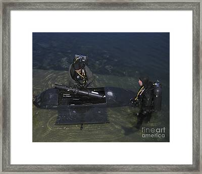 Divers Load Equipment Into Their Seal Framed Print by Michael Wood