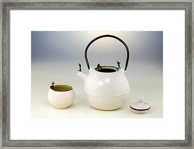 Diving On Tea Pot And Cup Framed Print by Paul Ge