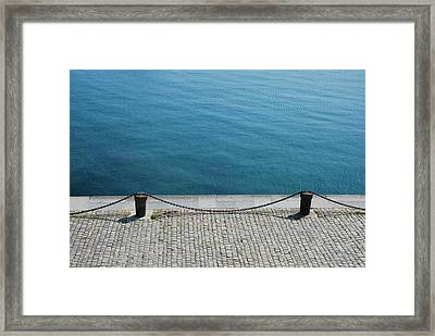 Dock Chain By Pavement Framed Print by Photography by Kévin Niglaut