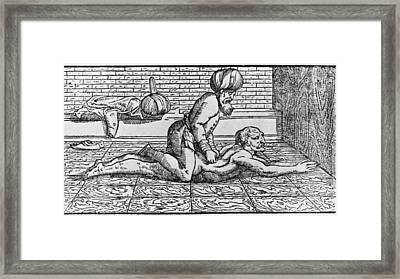 Doctor Massaging A Patients Back Framed Print
