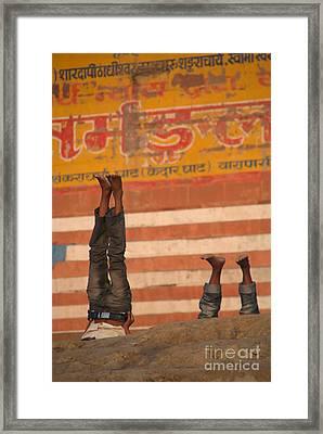 Doing Yoga On The Ghats At Varanasi Framed Print
