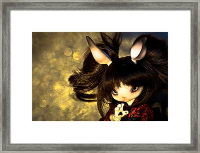 Doll And Bokehs Framed Print by Michael Huang
