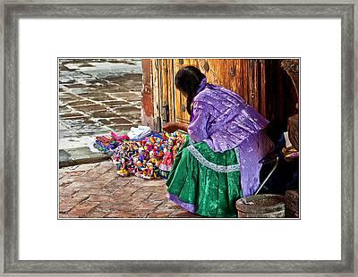 Dolls For Sale Framed Print by Javier Barras