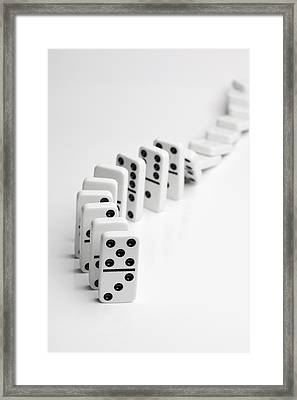 Dominoes Falling Over In A Chain Reaction Framed Print by Larry Washburn