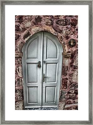 Door In Santorini Framed Print by Tom Prendergast