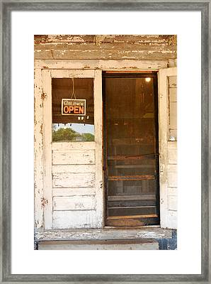 Door To A Country Store Framed Print by Connie Fox