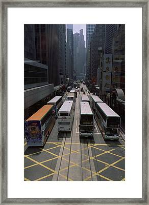 Double Decker Buses In The Streets Framed Print by Justin Guariglia