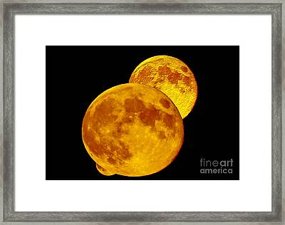 Double Full Moon And Black Sky Special Effects Framed Print by Carol F Austin