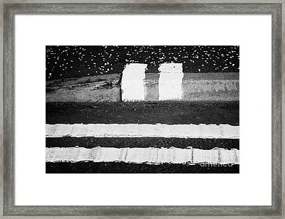 double yellow lines road and no loading kerb pavement markings in Glasgow Scotland UK Framed Print by Joe Fox