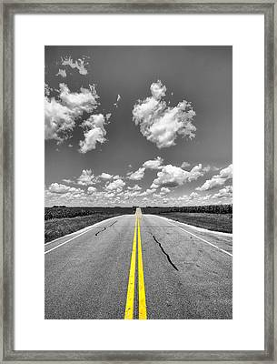 Down A Black And White Road Framed Print by Bill Tiepelman