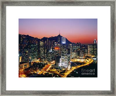 Downtown Hong Kong At Dusk Framed Print by Jeremy Woodhouse