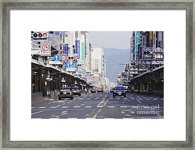 Downtown Street In Japan Framed Print by Jeremy Woodhouse
