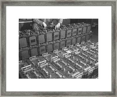 Dozens Of 12 Volt Rechargeable Framed Print by Everett