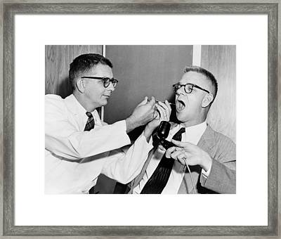 Dr. Harry L. Williams Squirts Lsd Framed Print by Everett