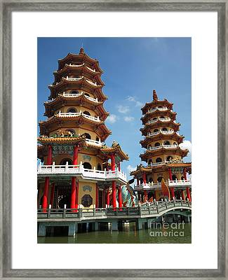 Dragon And Tiger Pagodas In Taiwan Framed Print by Yali Shi