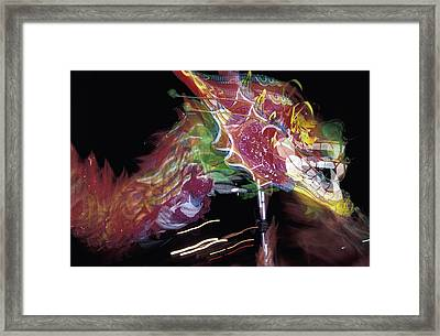 Dragon Dancing During Local Festival Framed Print by Axiom Photographic