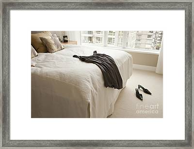 Dress Lying On Bed Framed Print by Shannon Fagan
