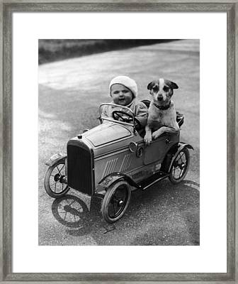 Driving Dog Framed Print by Norman Smith