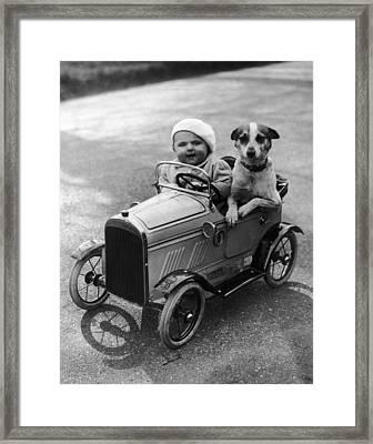 Driving Dog Framed Print