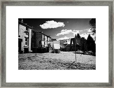 Drying Washing On A Washing Line At The Rear Of Tenement Buildings In Kilmarnock Scotland Framed Print by Joe Fox