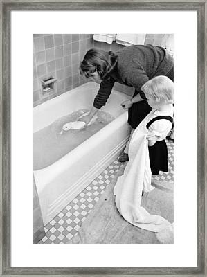 Duck Bath Framed Print