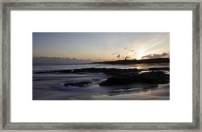 Dunstanburgh Castle Sunrise Framed Print by David Pringle