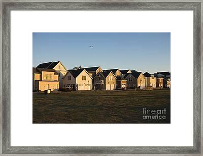 Duplexes Near Grassy Field Framed Print