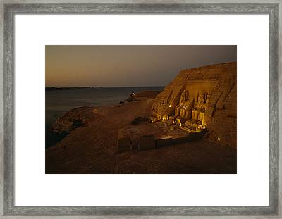Dusk Descends On Abu Simbel With Lake Framed Print by O. Louis Mazzatenta