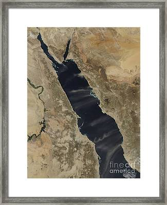 Dust Plumes Over The Red Sea Framed Print by Stocktrek Images