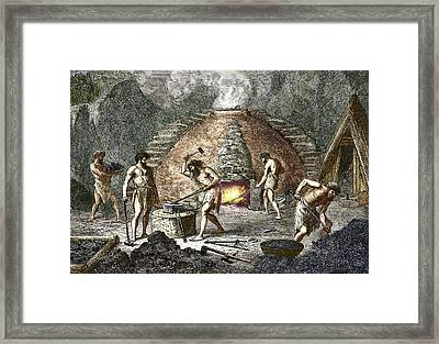 Early Humans Smelting Iron Framed Print by Sheila Terry
