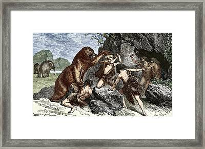 Early Humans Using Weapons Framed Print