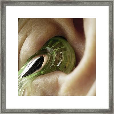 Earphone In An Ear Framed Print