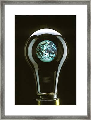 Earth In Light Bulb  Framed Print by Garry Gay