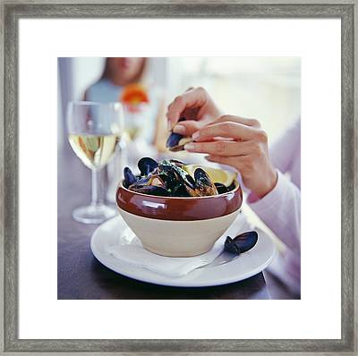 Eating Mussels Framed Print by David Munns
