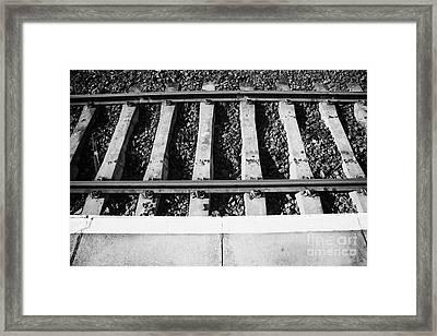 Edge Of Railway Station Platform And Track Northern Ireland Uk Framed Print by Joe Fox