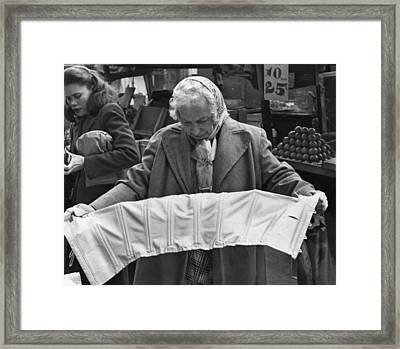 Elderly Woman Evaluating A Corset Framed Print by Everett