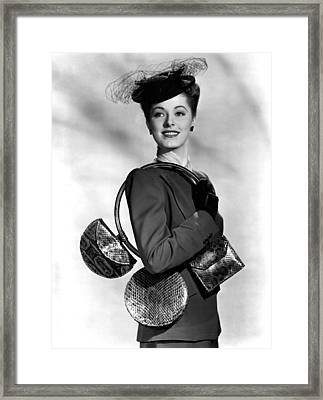 Eleanor Parker Carrying 3 Small Framed Print by Everett