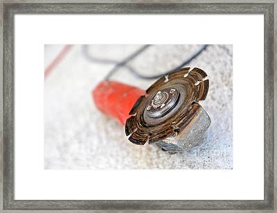 Electrical Saw On Floor Framed Print by Sami Sarkis