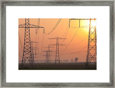 Electricity Pylons Framed Print by Hans Engbers
