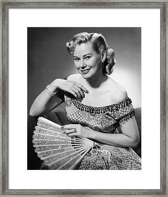 Elegant Woman Holding Fan Posing In Studio, (b&w), Portrait Framed Print by George Marks