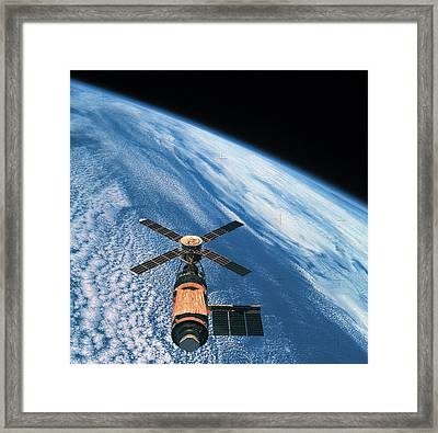 Elevated View Of A Satellite Orbiting In Space Framed Print by Stockbyte