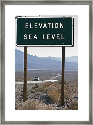 Elevation Sea Level Sign And Highway Framed Print by Rich Reid