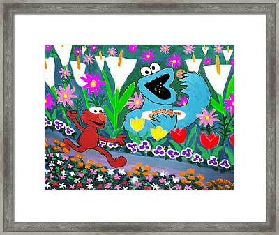 Elmo And The Cookie Monster Framed Print