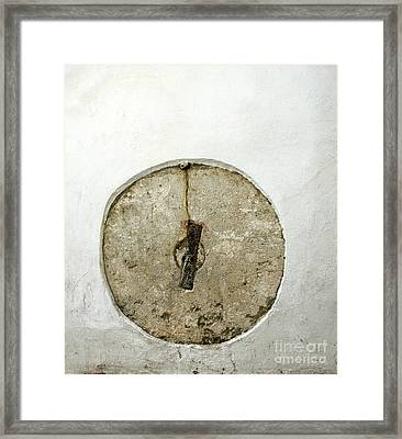 Embedded Millstone In A Street Of Seville  Framed Print by Perry Van Munster