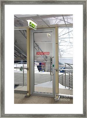 Emergency Exit At An Airport Framed Print by Jaak Nilson