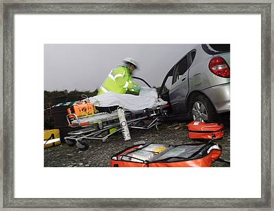 Emergency Treatment Framed Print by Michael Donne