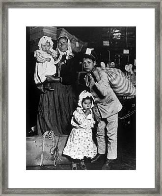Emigrants At New Yorks Ellis Island Framed Print by Everett