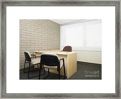 Empty Desk In An Office Framed Print by Skip Nall