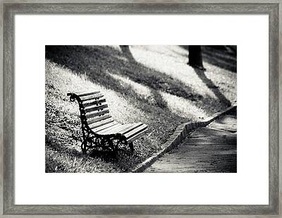 Empty Park Bench On Edge Framed Print by (c) Conrado Tramontini